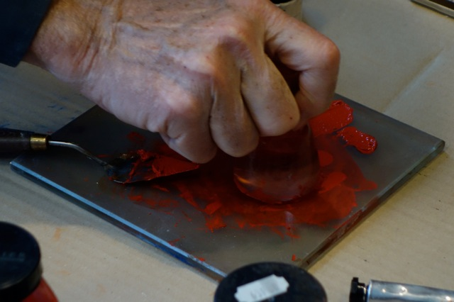 The hands of Dominique Sennelier making oil paint
